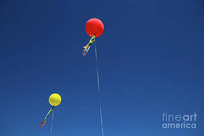Photograph - Red,yellow Balloon Blowing By The Wind In The Air With The Blue  by Jingjits Photography