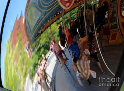Photograph - Reflection Of A Merry Go Round by Lennie Malvone