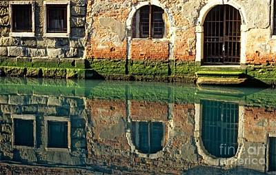 Reflection On Canal In Venice Art Print by Michael Henderson