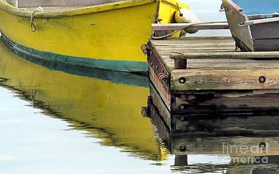 Photograph - Reflections Of Yellow Skiff by Janice Drew