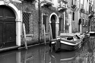 Photograph - Reflections On A Canal In Venezia by John Rizzuto