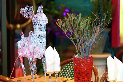 Photograph - Reindeer On The Bistro Table by John Rizzuto