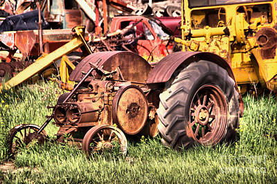 Photograph - Remains Of An Old Farm Tractor by Jeff Swan