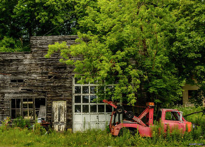 Remains Of An Old Tow Truck And Garage Art Print by Ken Morris