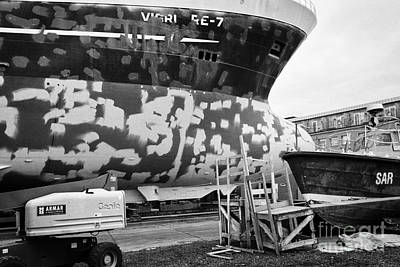 Repairing And Painting Hull Of A Ship In Dry Dock In Reykjavik Harbour Iceland Art Print by Joe Fox