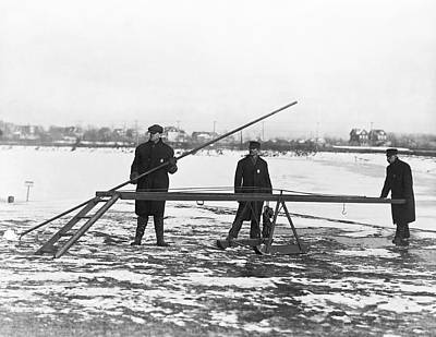 Cold Temperature Photograph - Rescue For Skating On Thin Ice by Underwood Archives