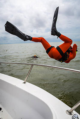 Photograph - Rescue Swimmer Overboard by Gregory Daley  PPSA