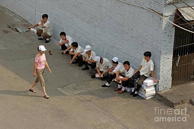 Restaurant Workers Having A Break Outside As A Woman Walks Past Art Print