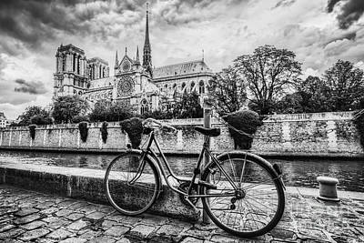Dark Photograph - Retro Bike Next To Notre Dame Cathedral In Paris, France. Black And White by Michal Bednarek