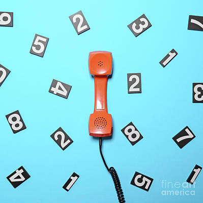 Pop Photograph - Retro Orange Telephone Tube With Numbers Around It On Blue Backg by Aleksandar Mijatovic