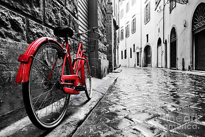 Creativity Photograph - Retro Vintage Red Bike On Cobblestone Street In The Old Town by Michal Bednarek