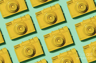 Photograph - Retro Yellow Cameras On Green Background by Michal Bednarek