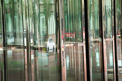 Photograph - Revolving Doors by Ross Odom