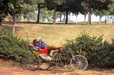 Travel Pics Royalty Free Images - Rickshaw Rider Relaxing Royalty-Free Image by Travel Pics