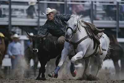 Ricky Huddleston Drops Off His Horse Print by Bobby Model