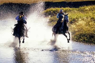 Riders In A Creek Art Print by Inga Spence