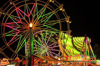 Photograph - Rides At Fairferris Wheels by Jim Corwin