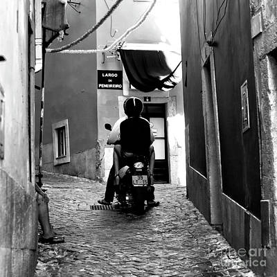 Photograph - Riding In Alfama Square by John Rizzuto
