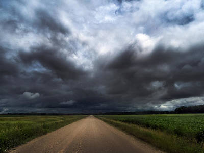 Photograph - Riding Into Dark Clouds by Eric Benjamin
