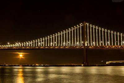 Photograph - Rising Moon Under The Bay Bridge by Bonnie Follett