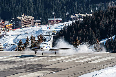 Flying Photograph - Risky Landing A Pilatus Pc12 At Courchevel. Oo-pci by Roberto Chiartano