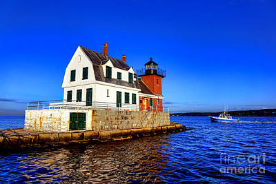 Rockland Harbor Light And Fishing Boat Art Print