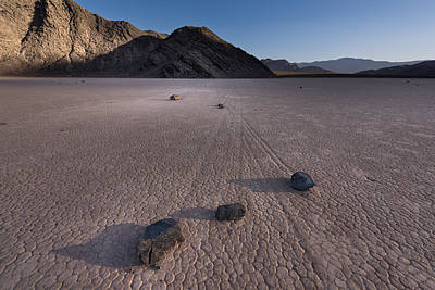 Sunset Sailing Photograph - Rocks On The Racetrack Death Valley by Steve Gadomski