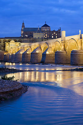 Roman Bridge On Guadalquivir River At Dawn Art Print by Artur Bogacki