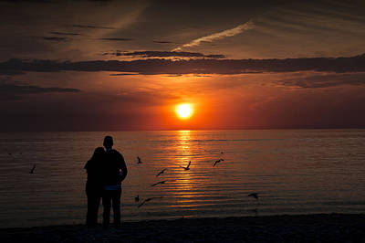 Romantic Couple Watching The Days Last Light Art Print by Randall Nyhof