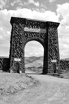Photograph - Roosevelt Arch 1903 Gate Old Time Dirt Road Yellowstone National Park Black And White by Shawn O'Brien