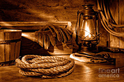 Oil Lamp Photograph - Rope And Tools In A Barn - Sepia by Olivier Le Queinec