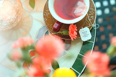 Canon Eos 5d Mark Iii Photograph - Rosehip Tea And Flower by Yuri Figuenick