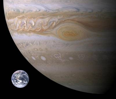 Photograph - Rough Visual Comparison Of Jupiter And Earth by Artistic Panda
