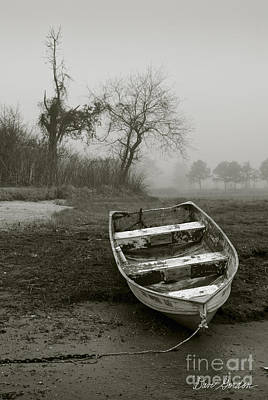 Row Boat And Low Tide Art Print by Dave Gordon