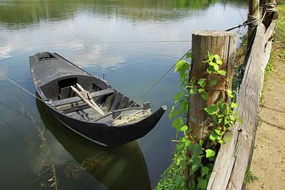 Row Boat On The Shoreline Art Print by Carlos Caetano