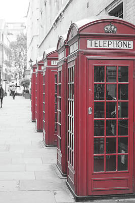 Photograph - Row Of Red Telephone Boxes In London by Jacek Wojnarowski