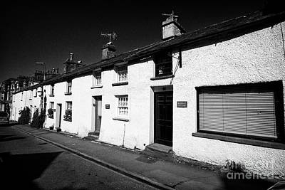 Ambleside Wall Art - Photograph - row of small traditional cottages on church st Ambleside now mostly holiday rentals lake district cu by Joe Fox