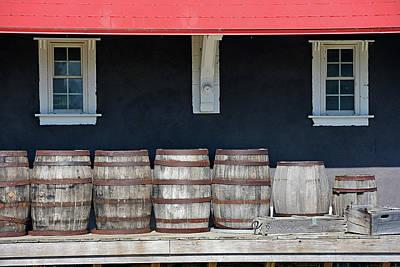 Row Of Wooden Barrels Art Print by Maria Dryfhout