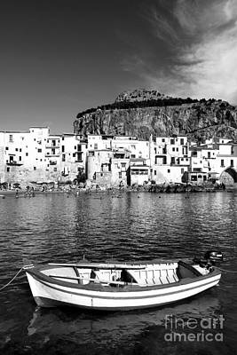 Rowboat Along An Idyllic Sicilian Village. Art Print