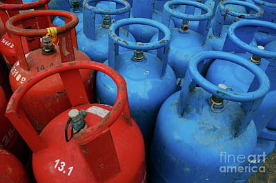 Row Of Bottles Photograph - Rows Of Blue And Red Domestic Gas Bottles by Sami Sarkis