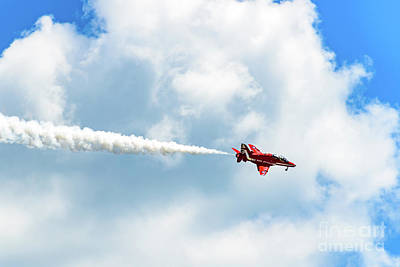 Photograph - Royal Air Force Red Arrow Plane Against A Cloud In Greece by Global Light Photography - Nicole Leffer