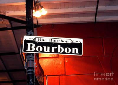 Photograph - Rue Bourbon Lights New Orleans by John Rizzuto