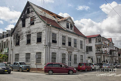 Photograph - Run Down Building With Fire Damage In Paramaribo by Patricia Hofmeester