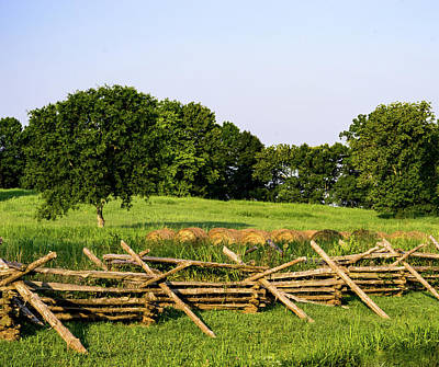 Photograph - Rural Setting Of Pasture Hay Bales And Cross Tie Fence by Douglas Barnett