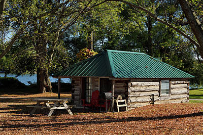 Photograph - Rustic Log Cabin In The Fall On Lake On The Mountain Provincial  by Reimar Gaertner