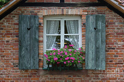 Photograph - Rustic Window And Red Bricks Wall by Yair Karelic