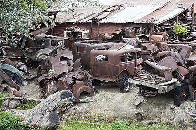 Rusting Antique Cars Art Print by Inga Spence