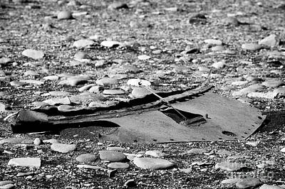 Rusty Car Undertray Left On Stony Pebble Beach In Iceland Art Print by Joe Fox