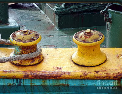 Photograph - Rusty Mooring Post With A Thick Rope by Yali Shi