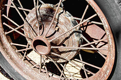 Photograph - Rusty Spoke Wheel by David Lawson